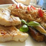 Alaskan fish fillets with tomato & garlic rice